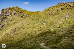 The path heads for a rocky outcrop